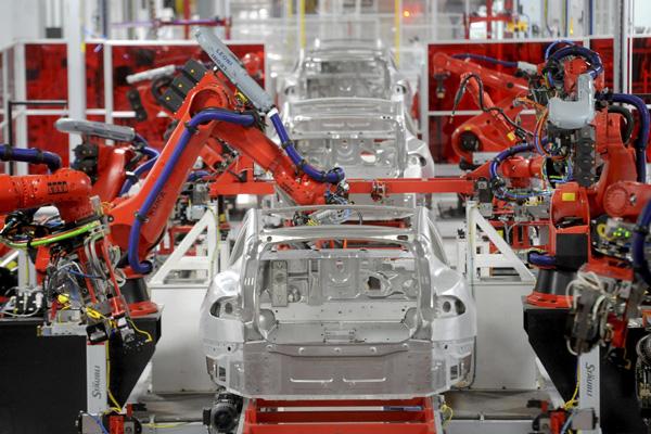 промышленный роботы в машиностроение - Tesla
